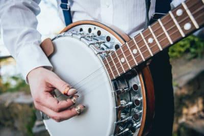 Fingerpicks scraping the banjo head surface